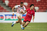 Dan Norton of England runs with the ball while Nathan Hirayama of Canada (right) tries to stop him during the match Canada vs England, Day 2 of the HSBC Singapore Rugby Sevens as part of the World Rugby HSBC World Rugby Sevens Series 2016-17 at the National Stadium on 16 April 2017 in Singapore. Photo by Victor Fraile / Power Sport Images