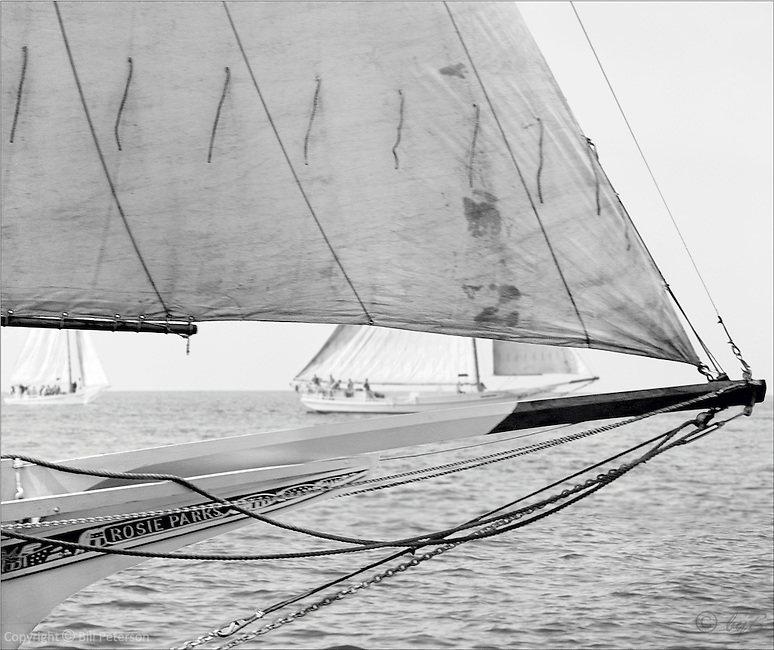 """Chesapeake Bay Skipjack Rosie Parks sails to victory in the 1967 Deal Island Skipjack race in this digitally restored photograph from the Limited Edition,Fine Art """"Skipjack Sunday"""" collection."""