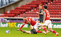 21st November 2020, Oakwell Stadium, Barnsley, Yorkshire, England; English Football League Championship Football, Barnsley FC versus Nottingham Forest; Cauley Woodrow of Barnsley  is upended