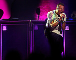 """Linkin Park's Chester Bennington sings during the """"MUSIC FOR RELIEF: REBUILDING SOUTH ASIA"""" BENEFIT SHOW at The Pond of Anaheim, Friday night in Anaheim."""