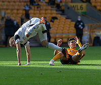 Wolverhampton Wanderers' Raul Jimenez (right) tackle brings down Fulham's Maxime Le Marchand (left)  <br /> <br /> Photographer David Horton/CameraSport<br /> <br /> The Premier League - Wolverhampton Wanderers v Fulham - Sunday 4th October 2020 - Molineux Stadium - Wolverhampton<br /> <br /> World Copyright © 2020 CameraSport. All rights reserved. 43 Linden Ave. Countesthorpe. Leicester. England. LE8 5PG - Tel: +44 (0) 116 277 4147 - admin@camerasport.com - www.camerasport.com