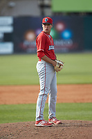 Lakewood BlueClaws relief pitcher Jonathan Hennigan (18) looks to his catcher for the sign against the Kannapolis Intimidators at Kannapolis Intimidators Stadium on April 8, 2018 in Kannapolis, North Carolina.  The Intimidators defeated the BlueClaws 4-3 in game two of a double-header.  (Brian Westerholt/Four Seam Images)