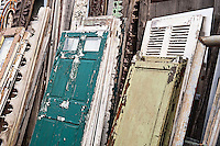 Reclaimed shutters and doors at a salvage yard.