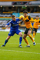 7th February 2021; Molineux Stadium, Wolverhampton, West Midlands, England; English Premier League Football, Wolverhampton Wanderers versus Leicester City; Harvey Barnes of Leicester City and Ki-Jana Hoever of Wolverhampton Wanderers challenge for the ball