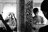Boys wash their faces at morning. Dhaka, Bangladesh.