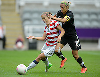 Newcastle, England - Friday, August 3, 2012: The USA women defeated New Zealand 2-0 in the quarterfinal round of the 2012 Olympics at St. James Park. Alex Morgan battles for the ball with Rebecca Smith.