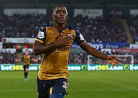 Joel Campbell of Arsenal celebrates scoring his goal to make the score 0-3 during the Barclays Premier League match between Swansea City and Arsenal played at The Liberty Stadium, Swansea on October 31st 2015