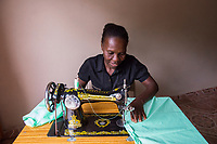 Haiti, Gros-Morne. Mercy Beyond Borders projects. Women in sewing training class. Sylvani is a widow with five children and this income will help raise them.