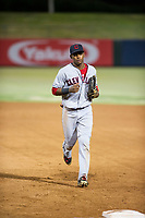 AZL Indians left fielder Ronny Dominguez (6) jogs to the dugout between innings during a game against the AZL Angels on August 7, 2017 at Tempe Diablo Stadium in Tempe, Arizona. AZL Indians defeated the AZL Angels 5-3. (Zachary Lucy/Four Seam Images)