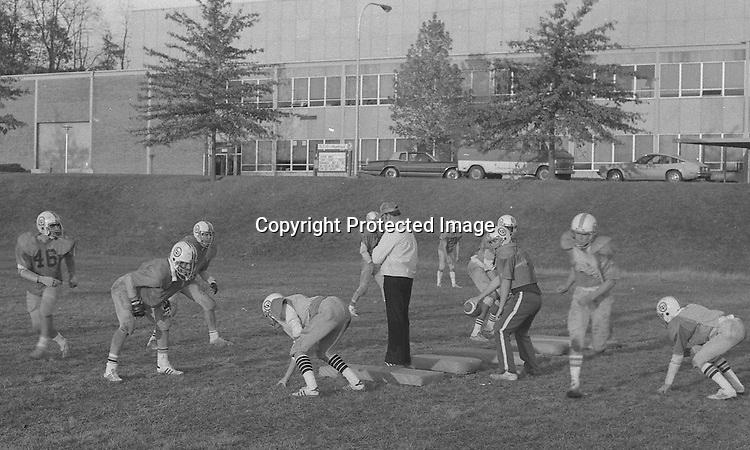 Bethel Park PA:  Bethel Park Football Head Coach Bob King watching skeleton drills. <br /> Notable players included; future college and NBA star Armen Gilliam (DE), Shawn Morton QB, Steve Berlin (T), Eric Coss (T), Van Richardson (LB), Evan Evanovich (TE).<br /> The team made a great run in the WPIAL AAAA playoffs beating the #2 rated high school football team in the nation, North Hills in 3 overtimes, and then top 5 Gateway the next week.  Came up a little short against Mt Lebanon in the championship game at Pitt Stadium.<br /> Coaches included Head Coach & OC Bob King, Don Porter (DC), Dave George (LB, TE), Leo Henne (DL), Dave Luptak (R, DB), Gerard Runco (R, Secondary), Chuck Boig (QB, DB) and Mike Stewart (RB, DB).