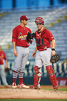 Palm Beach Cardinals starting pitcher Jack Flaherty (34) talks with catcher Steve Bean (11) during a game against the Bradenton Marauders on August 8, 2016 at McKechnie Field in Bradenton, Florida.  Bradenton defeated Palm Beach 5-4 in 11 innings.  (Mike Janes/Four Seam Images)