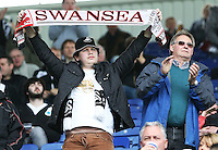 A Swansea fan holds a scarf up before the Barclays Premier League match between Leicester City and Swansea City played at The King Power Stadium, Leicester on April 24th 2016