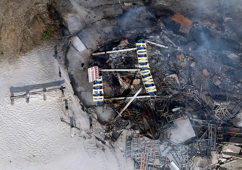 SEASIDE PARK, NJ (Sept. 13, 2013) - Funtown Pier sign lies in the smoldering ruins in an overhead view of the devastation the morning after the fire.