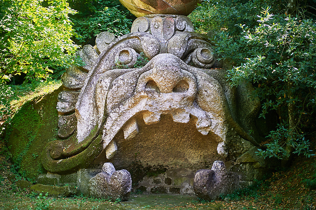 Statue of the head of Proteus, son of Neptune, the globe and castle on its head symolises the castle of Orsini and its rule over the world, commissioned by Piaer Francesco Orsini c. 1513-84, The Renaissance Mannerist statues of the Park of Monsters or The Sacred Wood of Bamarzo, Italy
