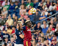 FOXBOROUGH, MA - SEPTEMBER 21: Antonio Mlinar Delamea #19 of New England Revolution  and Sam Johnson #50 of Real Salt Lake battle for head ball during a game between Real Salt Lake and New England Revolution at Gillette Stadium on September 21, 2019 in Foxborough, Massachusetts.