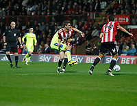 Chris Mepham of Brentford stops  Joe Ledley of Derby County in his tracks during the Sky Bet Championship match between Brentford and Derby County at Griffin Park, London, England on 26 September 2017. Photo by Carlton Myrie / PRiME Media Images.