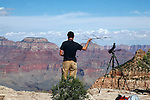 Ornithologist at work at the Grand Canyon<br /> <br /> Man holds antenna in hopes of  monitoring the behavior and whereabouts of the California condor