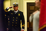 WATERBURY, CT. 20 December 2019-122019BS243 - Newly appointed Waterbury Fire Chief Terry Ballou salutes as the national anthem is sung, during the Fire Chief swearing in ceremonies at City Hall on Friday. Terry Ballou replaces former Fire Chief David Martin, who retired earlier this year. Bill Shettle Republican-American