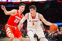 NEW YORK, NY - Sunday December 13, 2015: Amar Alibegovic (#1) of St. John's drives against Tyler Lydon (#20) of Syracuse as the two square off during the NCAA men's basketball regular season at Madison Square Garden in New York City.  St. John's would go on to win 84-72.