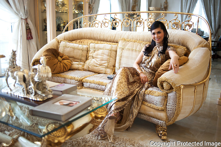 Former film actress and one of Vietnam's wealthiest women, Thuy Tien is the president of Imex Pan Pacific, a trading company that runs over 26 major businesses, including shopping malls, duty free fashion designer boutiques. Pictured here in a Ferragamo silk organza gown in her sitting room in high security riverside villa in Anphu, Saigon, a residential enclave with rich Vietnamese and expats.
