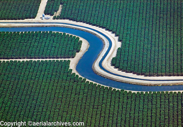 aerial photograph of California Aqueduct, Central Valley, California adjacent to orchards
