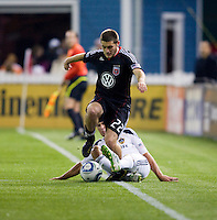 Chris Korb (22) of D.C. United escapes from the tackle of Todd Dunivant (2) of the LA Galaxy  during the game at RFK Stadium.  D.C. United tied the LA Galaxy, 1-1.