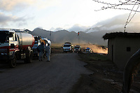 As dawn creeps over the horizon the other trucks catch up to the lead group who spent the night camped out by the side of the road.