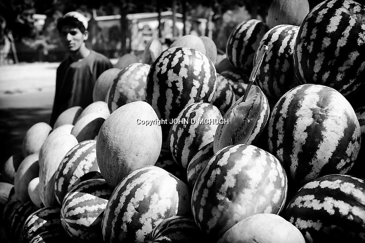 A fruit seller is seen on the streets of Herat, 20 September 2013. (John D McHugh)