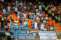 MEDELLIN-COLOMBIA, 18-02-2020: Hinchas Club Atletico Tucuman (ARG) animan a su equipo durante entre Deportivo Independiente Medellin (COL) y Club Atletico Tucuman (ARG), por la Copa Conmebol Libertadores 2020 en el estadio Atanasio Girardot de la ciudad de Medellin. / Fans of Club Atletico Tucuman (ARG), cheer for their team during a match between Deportivo Independiente Medellin (COL) and Club Atletico Tucuman (ARG), for the Copa Conmebol Libertadores 2020 at the Atanasio Girardot stadium in Medellin city. / Photo: VizzorImage  / Donaldo Zuluaga / Cont.