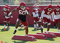 Eric Gregory participates in an agility drill during the University of Arkansas Razorback Spring football practice Thursday, April 1, 2021, at the University practice field on the campus in Fayetteville. Check out nwaonline.com/210402Daily/ and nwadg.com/photos for a photo gallery.<br /> (NWA Democrat-Gazette/David Gottschalk)