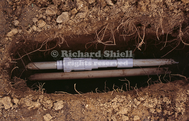 11651-QC Repaired Underground Pipe, PVC Irrigation Lateral, with slip fitting and adjustable splice unit glued in place at Bakersfield, CA USA