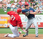 Los Angeles Angels Mike Trout tries to break up a double play against Mike Aviles and the Cleveland Indians.