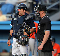 Empire State Yankees catcher Francisco Cervelli #3 talks with umpire Toby Basner during a game against the Norfolk Tides in the first ever Triple-A contest to be held at Dwyer Stadium on April 20, 2012 in Batavia, New York.  (Mike Janes/Four Seam Images)