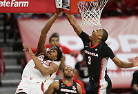 Arkansas guard Moses Moody (5) blocks as Georgia Christian Brown (3) drives the ball for a layup, Saturday, January 9, 2021 during the first half of a basketball game at Bud Walton Arena in Fayetteville. Check out nwaonline.com/210110Daily/ for today's photo gallery. <br /> (NWA Democrat-Gazette/Charlie Kaijo)
