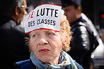 """A woman wears the """"Je lutte des classes"""" sticker (""""I class struggle""""), one of the most emblematic of the movement, at the September 15 demonstration..____________________________________________.2010 in France was marked by one of the largest social crisis as millions took to the streets during 3 months to oppose Sarkozy Government's reform of the pension law. The country came close to a standstill in October with gasoline shortage but before Christmas, the law was passed."""