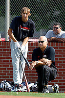 First baseman Ryan Ripken #20 prepares to bat as his father, Hall of Fame shortstop Cal Ripken Jr, looks on during practice for the Under Armour All-American Game presented by Baseball Factory at Les Miller Field on August 12, 2011 in Chicago, Illinois.  (Mike Janes/Four Seam Images)