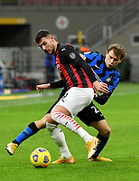 Football Soccer: Tim Cup Quarter Finals InternazionaleMIlan vs Milan, Giuseppe Meazza Stadium (San Siro) Milan, on January 26, 2021.<br /> Milan''s Theo Hernandez (r) in action with Inter's Nicolò Barella (r) during the Italian Tim Cup  football match between Inter  and Milan at the Giuseppe Meazza stadium in Milan, January 26, 2021.<br /> UPDATE IMAGES PRESS/Isabella Bonotto