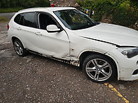 """Pictured: Another BMW car, damaged by the car driven by Amar Saleem on the A4118 in the Gower Peninsula, Wales, UK.<br /> Re: Amar Saleem, who was motoring around Gower looking for a romantic spot to ask his fiancee to marry him and subsequently crashed into two cars while speeding down a narrow lane, has been sentenced by Swansea Crown, Court, Wales, UK.<br /> Two oncoming vehicles he collided with were written off and his own car slid down the road on its side for more than 150 feet.<br /> Saleem, 24, from Newport denied he had been driving dangerously, but was found guilty following trial.<br /> The court heard that on July 19 last year Saleem was trying to find a possible location to propose to his fiancee.<br /> After rejecting award winning Rhossili as a possible site, the defendant and two friends  drove to nearby to Port Eynon.<br /> The court heard that as Saleem drove along a narrow section of the A4118, which has an advisory 25mph limit, he collided with the offsides of a Kia Sportage and a BWM coming in the other direction.<br /> It was described by a witness like a """"white flash"""" coming towards them, and estimated his speed to be around 60mph."""