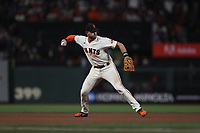 SAN FRANCISCO, CA - OCTOBER 9:  Evan Longoria #10 of the San Francisco Giants makes a play at third base against the Los Angeles Dodgers during Game 2 of the NLDS at Oracle Park on Saturday, October 9, 2021 in San Francisco, California. (Photo by Brad Mangin)