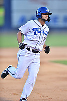Asheville Tourists Matt Barefoot (12) rounds the bases after hitting a home run during a game against the Greenville Drive on July 16, 2021 at McCormick Field in Asheville, NC. (Tony Farlow/Four Seam Images)