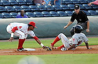 Third baseman Michael Amlanzar (25) of the Greenville Drive tags out Leandro Castro (18) the Lakewood BlueClaws in Game 1 of the South Atlantic League Championship Series on Sept. 13, 2010, at Fluor Field at the West End in Greenville, S.C. Photo by: Tom Priddy/Four Seam Images