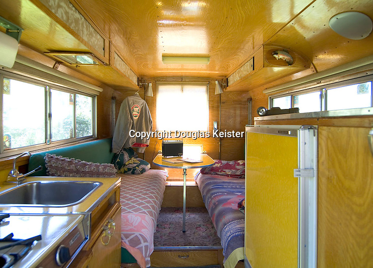 The interior view of the Alaskan Camper illustrates the ample 6 feet, 4 inches of headroom available when the top was raised. The 8- and 10-foot models had identical accessories, but the 10-foot model boasted a bigger dinette and sleeping area. Accouterments included a 3-burner propane stove, ice box, and pump-operated faucet with storage tank. Available options were a propane-powered refrigerator, propane furnace for those frigid Alaskan winters, and a stovetop oven.