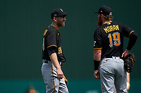 Pittsburgh Pirates third baseman Todd Frazier (99) talks with first baseman Colin Moran (19) during a Major League Spring Training game against the Minnesota Twins on March 16, 2021 at Hammond Stadium in Fort Myers, Florida.  (Mike Janes/Four Seam Images)