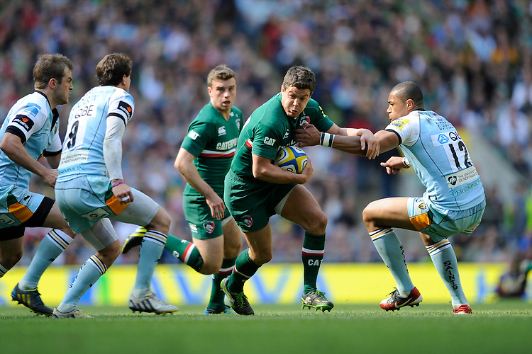 Anthony Allen of Leicester Tigers forces his way past Luther Burrell of Northampton Saints (right) during the Aviva Premiership Final between Leicester Tigers and Northampton Saints at Twickenham Stadium on Saturday 25th May 2013 (Photo by Rob Munro)
