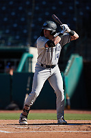 Elijah Dunham (14) of the Hudson Valley Renegades at bat against the Greensboro Grasshoppers at First National Bank Field on September 2, 2021 in Greensboro, North Carolina. (Brian Westerholt/Four Seam Images)