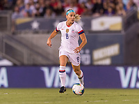 PASADENA, CA - AUGUST 4: Julie Ertz #8 dribbles during a game between Ireland and USWNT at Rose Bowl on August 3, 2019 in Pasadena, California.
