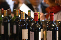 Wine tasting with bottles. Trade wine tasting UGC Union des Grands Crus, Bordeaux. Bordeaux, France
