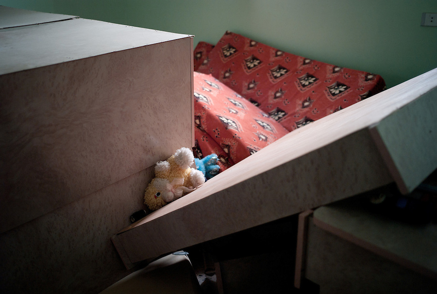 Child's bedroom in house of suspected Gaddafi loyalist in Bir Ayad, Libya.