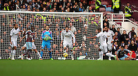 Sunday 07 December 2014<br /> Pictured: Wayne Routledge of Swansea (15) is kicking the ball away from the box<br /> Re: Premier League West Ham United v Swansea City FC at Boleyn Ground, London, UK.