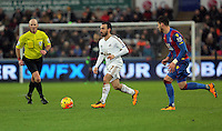 Leon Britton of Swansea (C) moves past Joel Ward of Crystal Palace (R) during the Barclays Premier League match between Swansea City and Crystal Palace at the Liberty Stadium, Swansea on February 06 2016